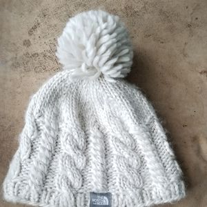 The North Face beige cable knit beanie cap